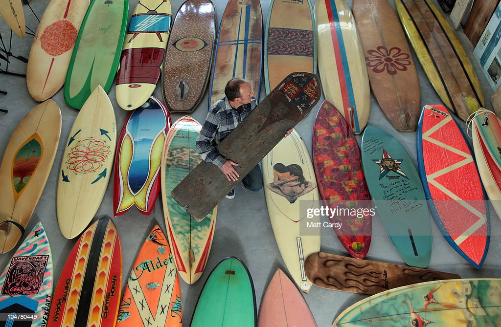 Peter Robinson, director of the Museum of British Surfing holds a 1920s era surfboard as he stands amongst part of the museum's surfboard collection, the largest in the UK and currently in storage, on October 4, 2010 in Braunton, England. The Museum of British Surfing, a charity which originally started online, has been touring the UK since 2004 and is Europe's first surf museum. It holds the largest surfboard collection in Britain and has secured funding for a permanent home, which will open in Braunton next summer. As well as the collection of surfboards dating back over 100 years, the museum also holds early wetsuits, photos and other memorabilia relating to the phenomenal growth in the popularity of surfing. Although many people assume surfing in the UK began in the 1960s, the museum contains evidence that show that it was in fact already a mass participant activity on British beaches by the end of the First World War. Surfing is now a multi-million pound industry and employs 1000s of people in the UK.