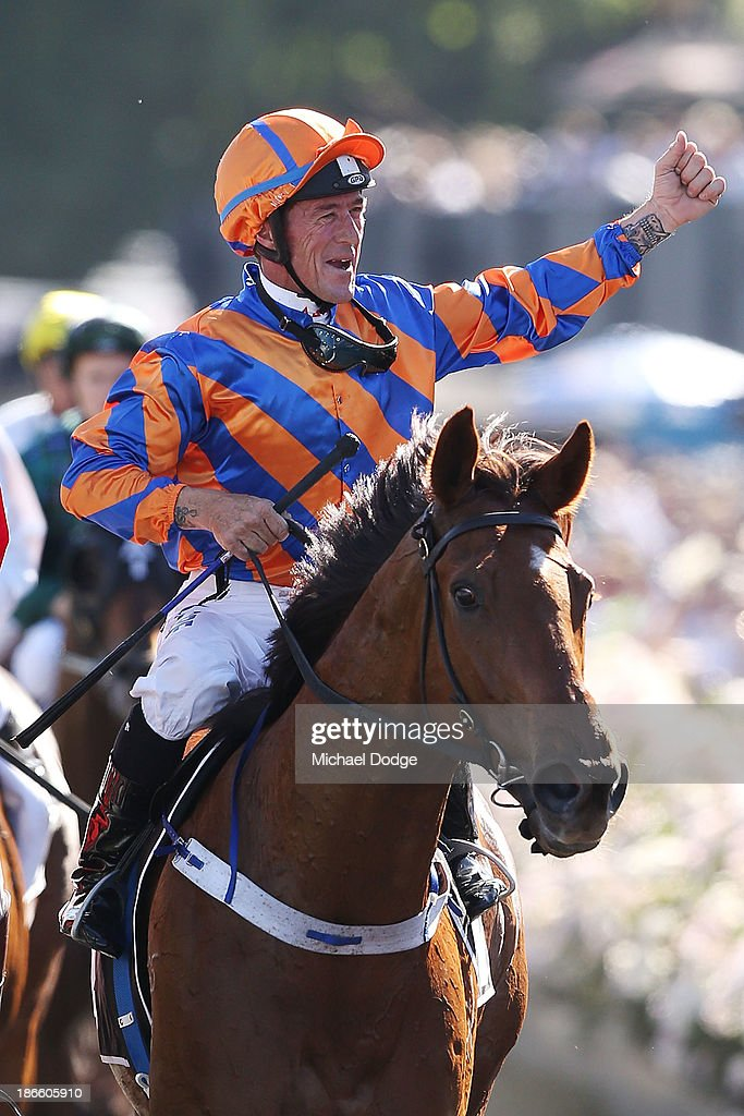 Peter Robl riding Fontelina returns to scale after winning race 8 the Yellowglen Stakes during Derby Day at Flemington Racecourse on November 2, 2013 in Melbourne, Australia.