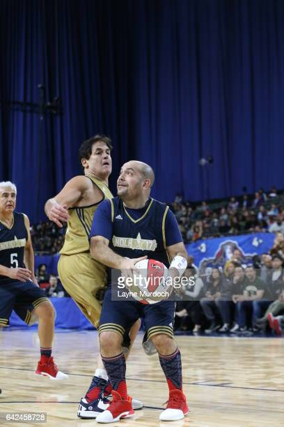 Peter Rosenberg of the East team drives against Mark Cuban of the West team during the 2017 NBA AllStar Celebrity Game as part of 2017 AllStar...