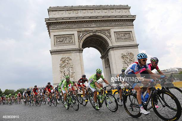 Peter Sagan of Slovakia and Cannondale rides around the 'Arc de Triomphe' on top of the Champs Elysees Avenue during the twenty one and last stage of...