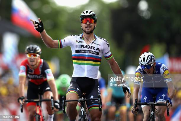 Peter Sagan of Slovakia and team BoraHansgrohe celebrates as he crosses the line to win stage 3 of the 2017 Tour de France a 2125km road stage from...