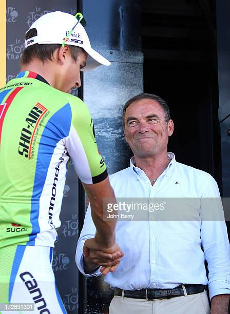 Peter Sagan of Slovakia and Team Cannondale shakes hands with Bernard Hinault after winning Stage Seven and retaining the points leader green jersey...