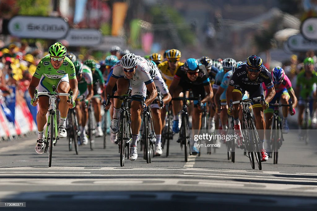 <a gi-track='captionPersonalityLinkClicked' href=/galleries/search?phrase=Peter+Sagan&family=editorial&specificpeople=4846179 ng-click='$event.stopPropagation()'>Peter Sagan</a> (L) of Slovakia and Team Cannondale with <a gi-track='captionPersonalityLinkClicked' href=/galleries/search?phrase=John+Degenkolb&family=editorial&specificpeople=5542317 ng-click='$event.stopPropagation()'>John Degenkolb</a> (C) of Germany and Team Argos-Shimano and <a gi-track='captionPersonalityLinkClicked' href=/galleries/search?phrase=Daniele+Bennati&family=editorial&specificpeople=584838 ng-click='$event.stopPropagation()'>Daniele Bennati</a> (R) of Italy and Team Saxo-Tinkoff sprint to the finish line during stage seven of the 2013 Tour de France, a 205.5KM road stage from Montpellier to Albi, on July 5, 2013 in Albi, France.