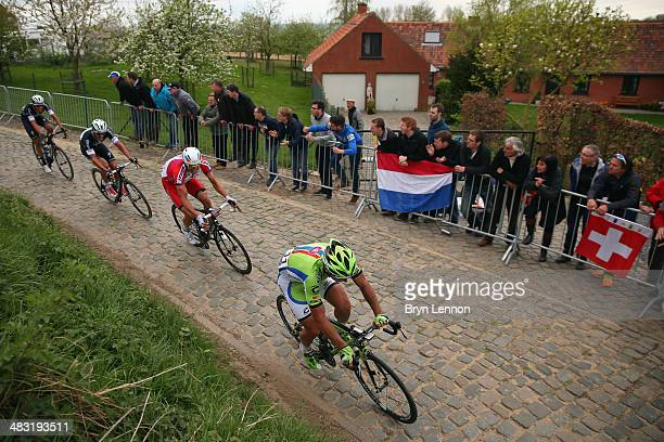 Peter Sagan of Slovakia and the Cannondale team leads a small goup of riders at the top of the Kwaremont during the 98th Tour of Flanders from Bruges...