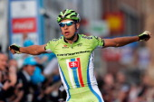 Peter Sagan of Slovakia celebrates as he crosses the finish line to win the E3 Harelbeke Cycle Race on March 28 2014 in Harelbeke Belgium