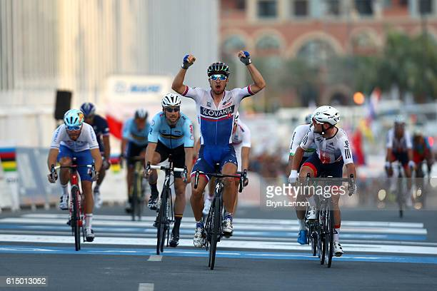 Peter Sagan of Slovakia celebrates victory as he crosses the finish line next to Mark Cavendish of Great Britain during the Elite Men's Road Race on...
