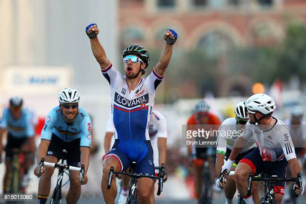 Peter Sagan of Slovakia celebrates victory as he crosses the finish line ahead of Mark Cavendish of Great Britain and Tom Boonen of Belgium in the...