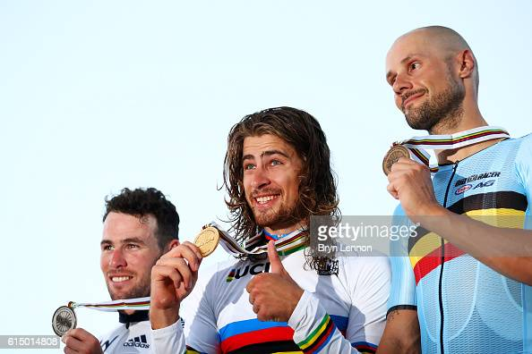 Peter Sagan of Slovakia celebrates victory on the podium next to secondplaced Mark Cavendish of Great Britain and thirdplaced Tom Boonen of Belgium...