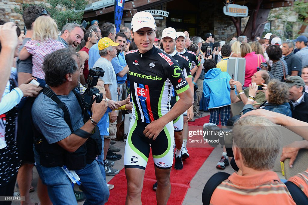 <a gi-track='captionPersonalityLinkClicked' href=/galleries/search?phrase=Peter+Sagan&family=editorial&specificpeople=4846179 ng-click='$event.stopPropagation()'>Peter Sagan</a> of Slovakia riding for Cannondale Pro Cycling walks down the red carpet at the team presentation ceremony prior to the start of the USA Pro Challenge on August 17, 2013 in Snowmass Village, Colorado.