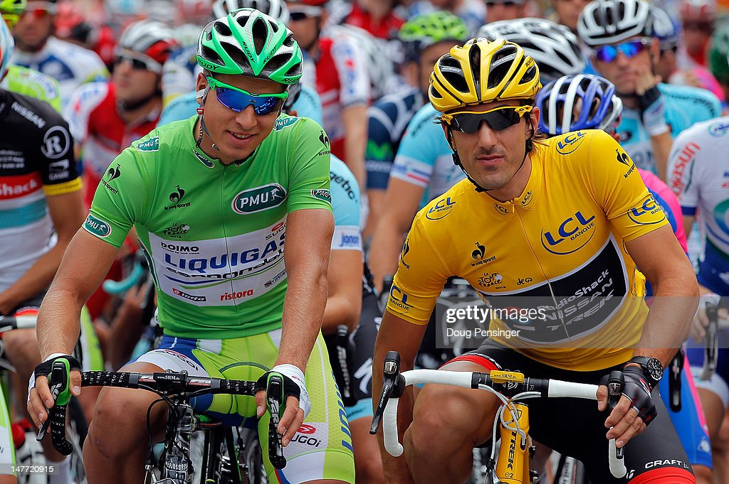 <a gi-track='captionPersonalityLinkClicked' href=/galleries/search?phrase=Peter+Sagan&family=editorial&specificpeople=4846179 ng-click='$event.stopPropagation()'>Peter Sagan</a> of Slovakia riding for Liquigas-Cannondale in the green points leader jersey and <a gi-track='captionPersonalityLinkClicked' href=/galleries/search?phrase=Fabian+Cancellara&family=editorial&specificpeople=573515 ng-click='$event.stopPropagation()'>Fabian Cancellara</a> of Switzerland riding for BMC Racing in the race leader yellow jersey prepare for the start as they both went on to defend their jerseys in stage two of the 2012 Tour de France from Vise to Tournai on July 2, 2012 in Vise, Belgium.