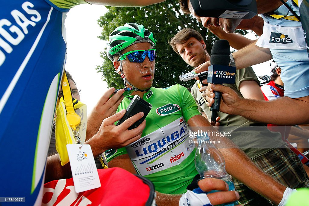 <a gi-track='captionPersonalityLinkClicked' href=/galleries/search?phrase=Peter+Sagan&family=editorial&specificpeople=4846179 ng-click='$event.stopPropagation()'>Peter Sagan</a> of Slovakia riding for Liquigas-Cannondale in the points leader's green jersey is interviewed by the media after stage two of the 2012 Tour de France from Vise to Tournai on July 2, 2012 in Tournai, Belgium.
