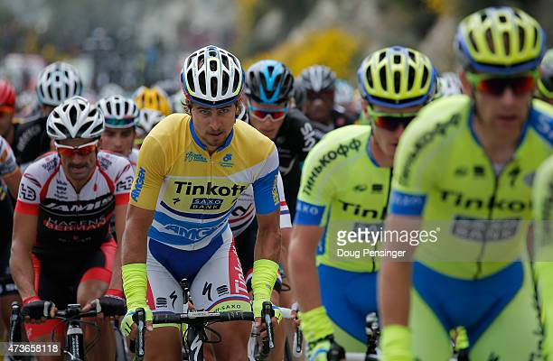Peter Sagan of Slovakia riding for TinkoffSaxo rides in the protection of his team as he attempts to defend the overall race leader yellow jersey in...