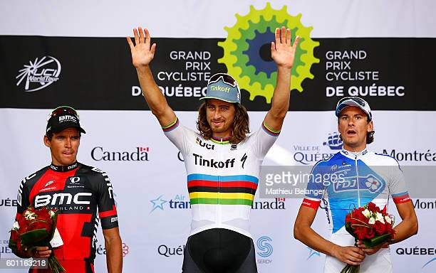 Peter Sagan of Team Tinkoff celebrates on the podium with Greg Van Avermaet of Team BMC Racing and Anthony Roux of Team FDJ after the Grand Prix...