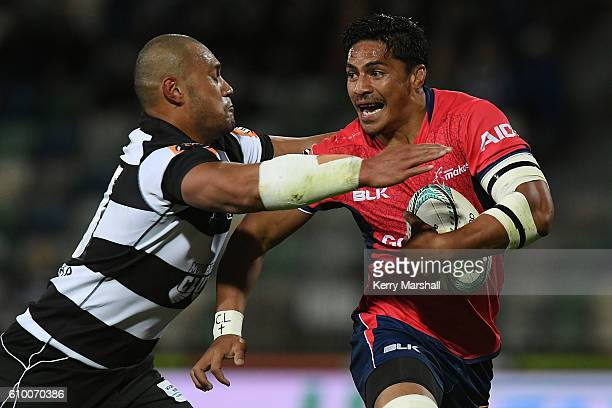 Peter Samu of Tasman trie to avoid the tackle of Robbie Fruean of Hawke's Bay during the round six Mitre 10 Cup match between the Hawke's Bay and...