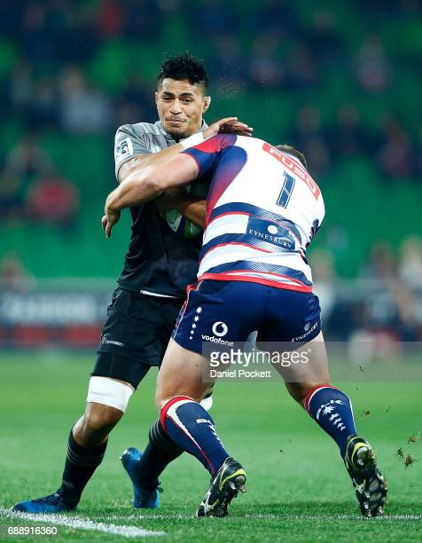 Peter Samu of the Crusaders is tackled by Toby Smith of the Rebels during the round 14 Super Rugby match between the Rebels and the Crusaders at AAMI...
