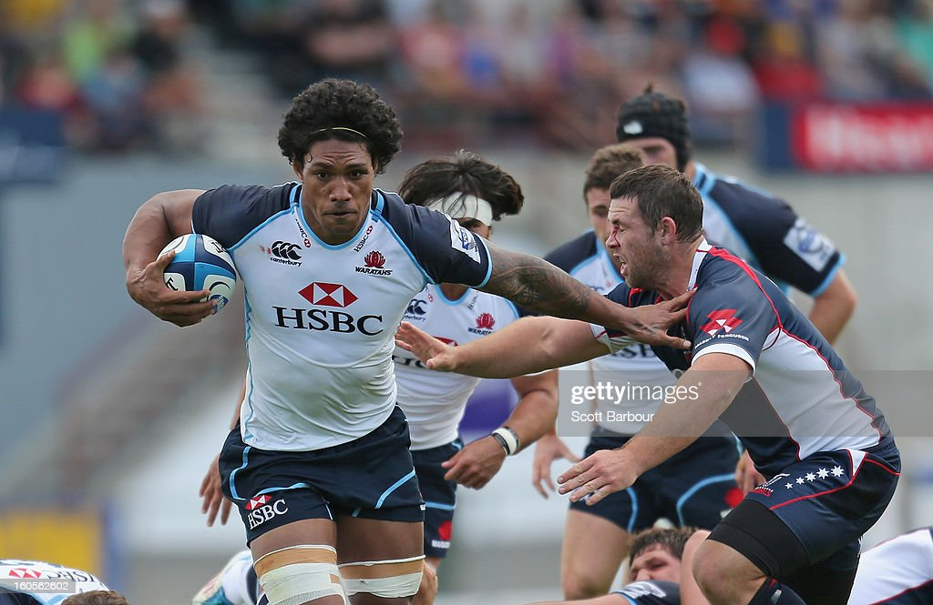 Peter Samu of the Waratahs is tackled during the Super Rugby trial match between the Waratahs and the Rebels at North Hobart Stadium on February 2, 2013 in Hobart, Australia.