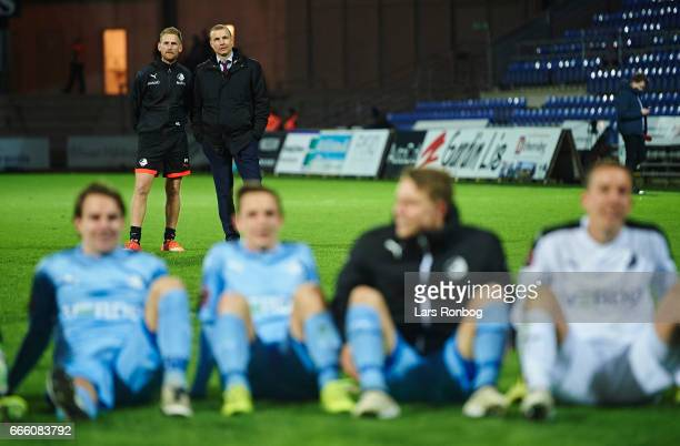 Peter Sand Sorensen physical coach of Randers FC and Michael Gravgaard CEO of Randers FC looks on after the Danish Alka Superliga match between...