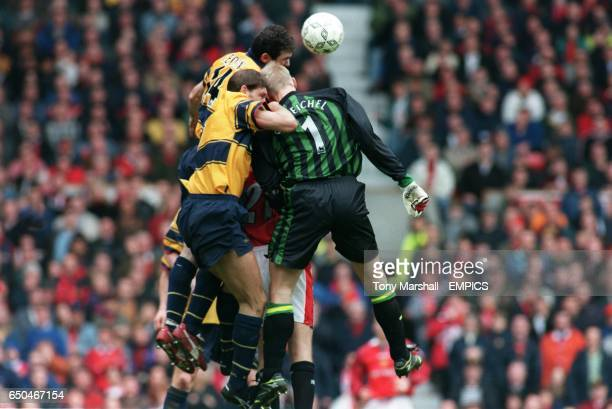 Peter Schemichel Manchester United jumps with Tony Adams and Martin Keown Arsenal in a bid to score for Manchester United the incident which made him...