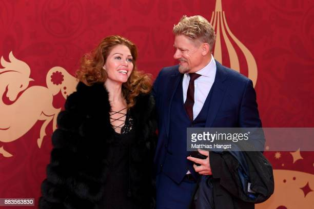 Peter Schmeichel and girlfriend Laura von Lindholm arrives prior to the Final Draw for the 2018 FIFA World Cup Russia at the State Kremlin Palace on...