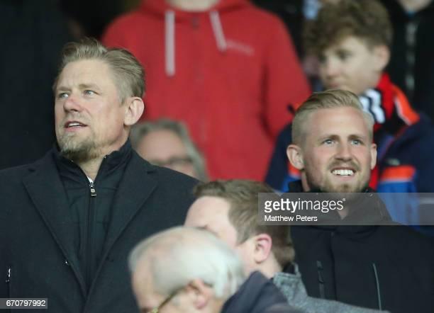 Peter Schmeichel and Kasper Schmeichel watch from the directors box during the UEFA Europa League quarter final second leg match between Manchester...