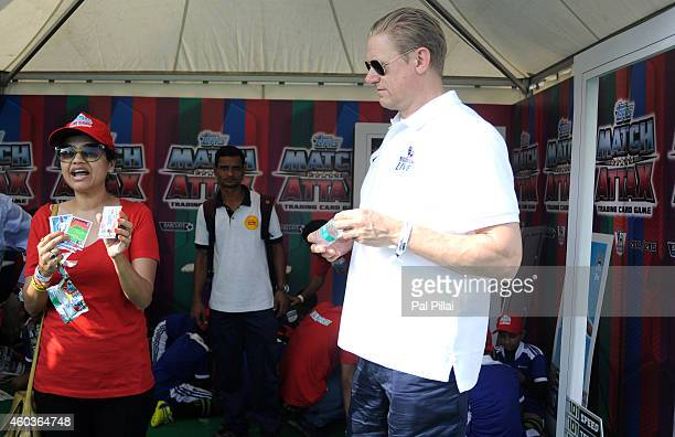 Peter Schmeichel BPL legend listen to an executive at the Match Attax trading card game tent during the Barclays Premier League 'Live' event on...