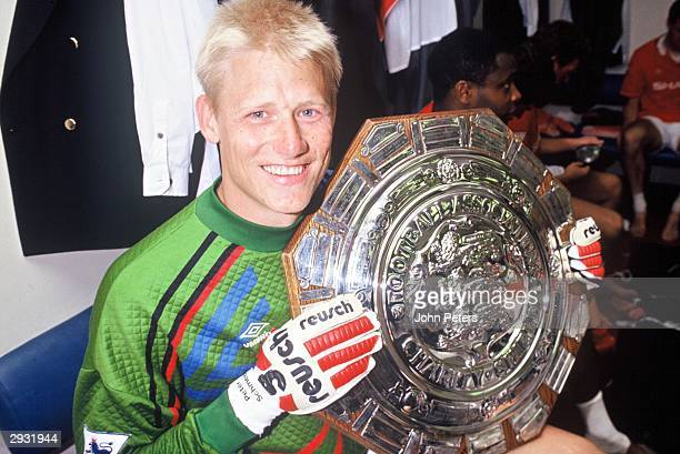 Peter Schmeichel celebrates in the dressing room after the Arsenal v Manchester United Charity Shield match at Wembley Stadium London on August 7...