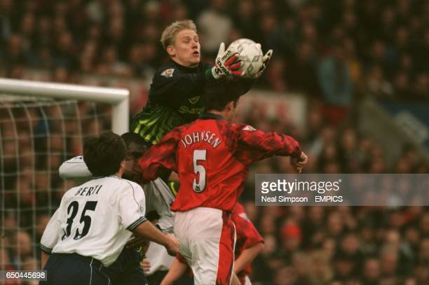 Peter Schmeichel of Manchester United catches a cross above teammate Ronny Johnsen and Nicola Berti and Sol Campbell of Tottenham Hotspur