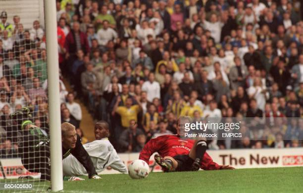 Peter Schmeichel of Manchester United Rod Wallace of Leeds United and Henning Berg of Manchester United watch the ball go past the post