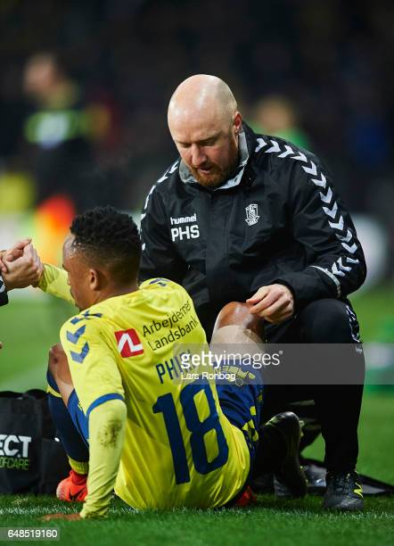 Peter Schmidt physio of Brondby IF in treatment of Lebogang Phiri of Brondby IF during the Danish Alka Superliga match between Brondby IF and FC...