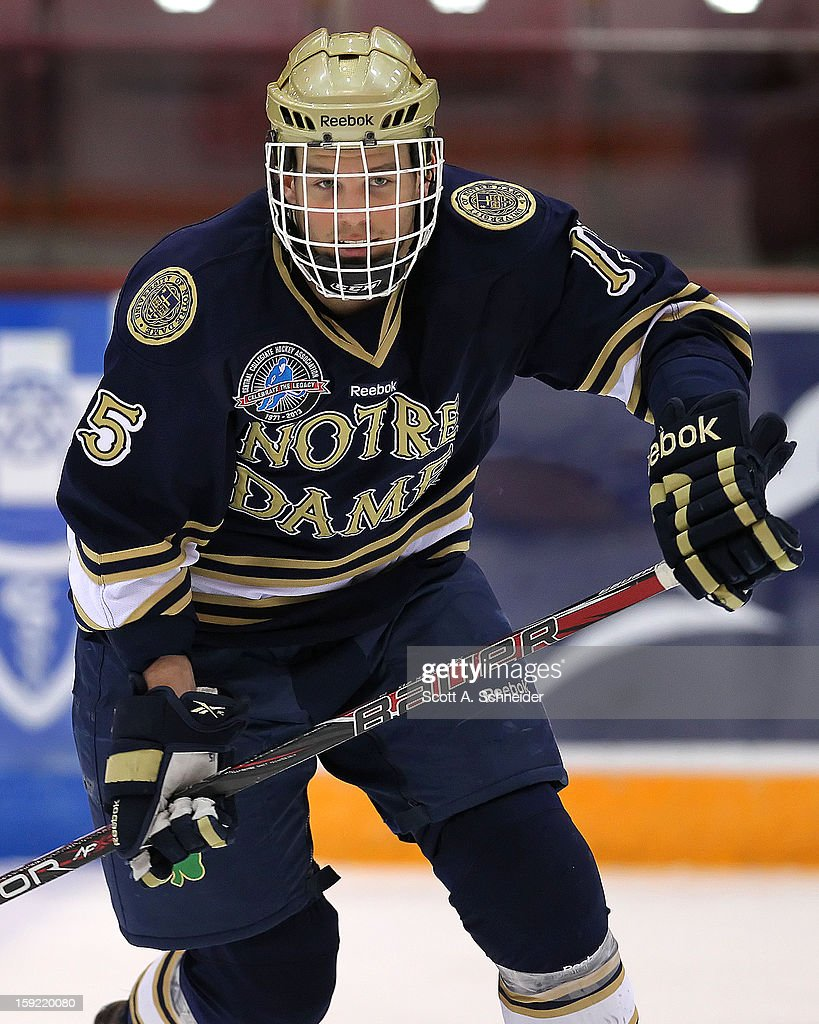 Peter Schneider #15 of the Notre Dame Fighting Irish warms up before a game against the Minnesota Gophers January 8, 2013 at Mariucci Arena in Minneapolis, Minnesota.