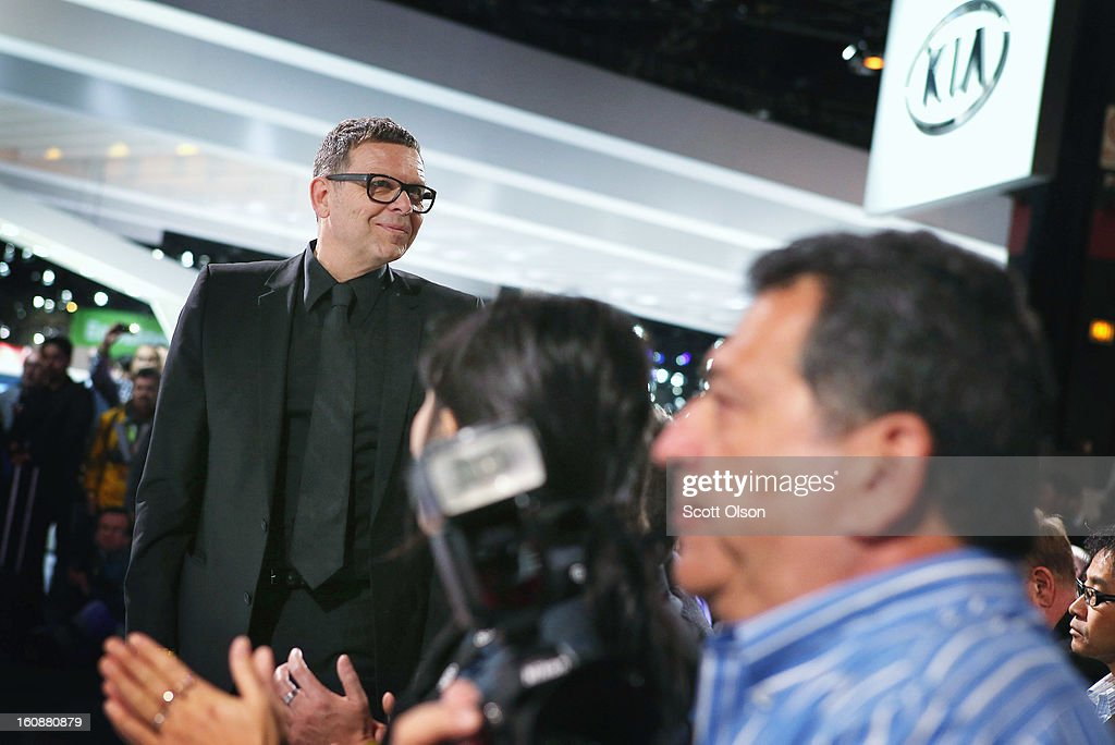 Peter Schreyer (L), president and chief design officer at Kia, is introduced at the Chicago Auto Show on February 7, 2013 in Chicago, Illinois. The Chicago Auto Show, one of the oldest and largest in the country, will be open to the public February 9-18.