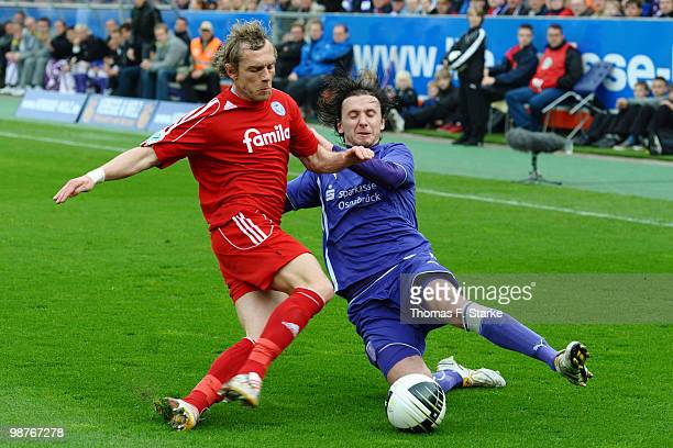 Peter Schyrba of Kiel and Henrich Bencik of Osnabrueck fight for the ball during the Third League match between VfL Osnabrueck and Holstein Kiel at...