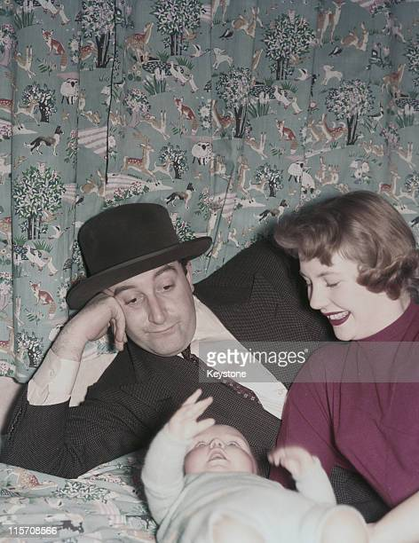 Peter Sellers British comedian and actor poses with his wife Anne Hayes and their baby son Michael Sellers England Great Britain in April 1954