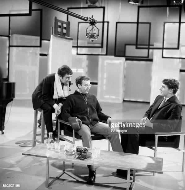 Peter Sellers centre gives his impression of a boxer who has turned to action painting during recording at the TV centre Shepherds Bush London of his...