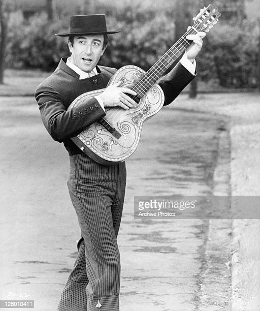 Peter Sellers with guitar in a scene from the film 'The Bobo' 1967
