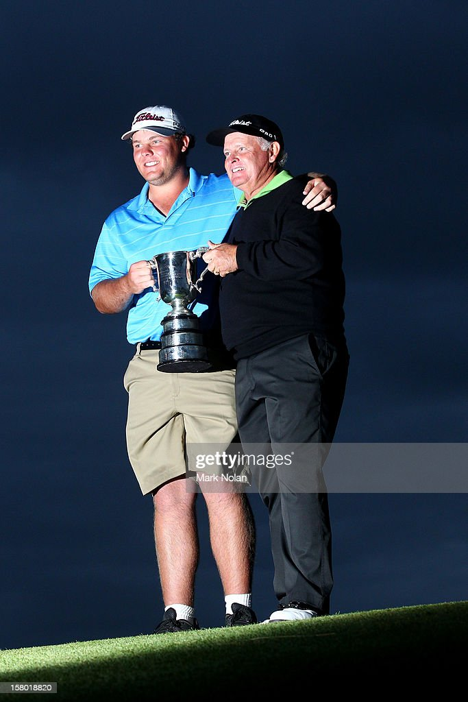 <a gi-track='captionPersonalityLinkClicked' href=/galleries/search?phrase=Peter+Senior&family=editorial&specificpeople=179459 ng-click='$event.stopPropagation()'>Peter Senior</a> of Australia and his caddie Mitch Senior pose with the trophy Peter won the 2012 Australian Open at The Lakes Golf Club on December 9, 2012 in Sydney, Australia.