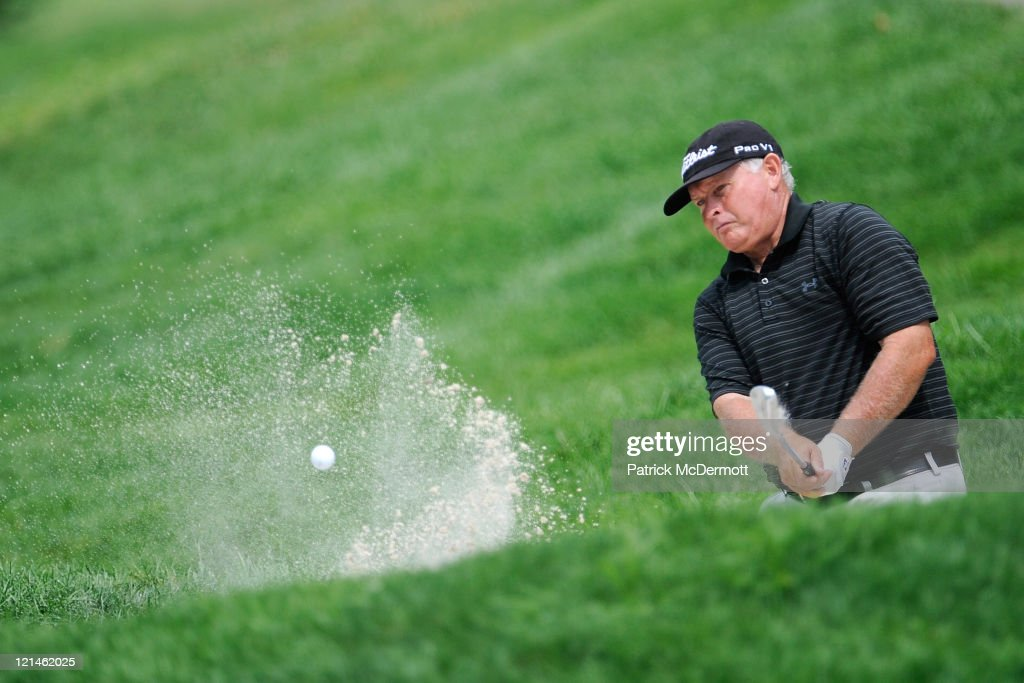 <a gi-track='captionPersonalityLinkClicked' href=/galleries/search?phrase=Peter+Senior&family=editorial&specificpeople=179459 ng-click='$event.stopPropagation()'>Peter Senior</a> of Australia plays from the bunker on the 12th green during the second round of the Constellation Energy Senior Players Championship at Westchester Country Club on August 19, 2011 in Rye, New York.