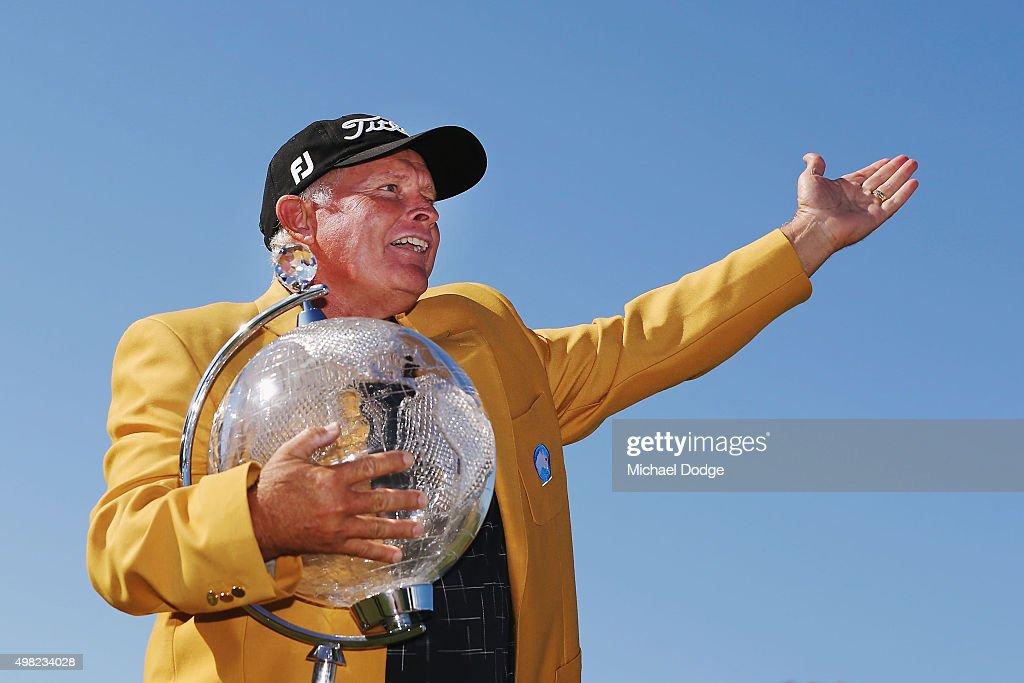 Peter Senior of Australia reacts to the crowd while posing with the trophy after winning during the final round of the 2015 Australian Masters at Huntingdale Golf Club on November 22, 2015 in Melbourne, Australia.