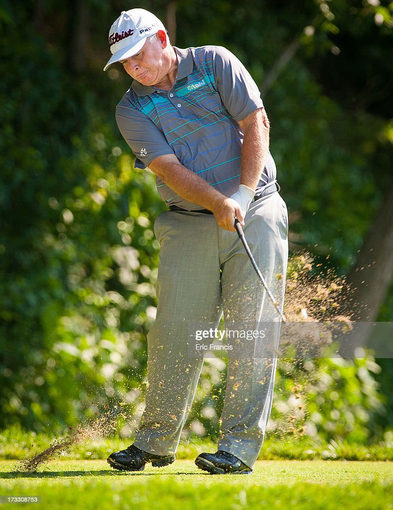 <a gi-track='captionPersonalityLinkClicked' href=/galleries/search?phrase=Peter+Senior&family=editorial&specificpeople=179459 ng-click='$event.stopPropagation()'>Peter Senior</a> of Australia tees off on the 16th hole during the first round of the 2013 U.S. Senior Open Championship at Omaha Country Club on July 11, 2013 in Omaha, Nebraska.