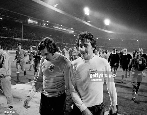 Peter Shilton and Roy McFarland of England leave the field after the World Cup qualifying match against Poland at Wembley London 17th October 1973...