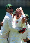 Peter Siddle and Brad Haddin of Australia celebrate after claiming the wicket of Virat Kohli of India during day one of the Second Test Match between...