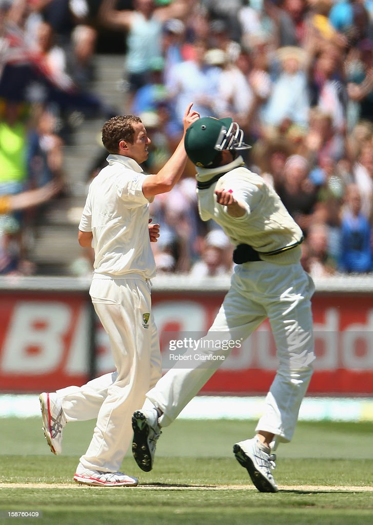 Peter Siddle and Ed Cowan of Australia celebrate after they dismissed Shaminda Eranga of Sri Lanka to give Australia victory during day three of the Second Test match between Australia and Sri Lanka at Melbourne Cricket Ground on December 28, 2012 in Melbourne, Australia.
