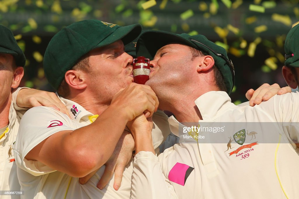 Peter Siddle and Michael Clarke of Australia kiss the urn celebrate victory in the test and the series during the presentation ceremony on day three of the Fifth Ashes Test match between Australia and England at Sydney Cricket Ground on January 5, 2014 in Sydney, Australia.