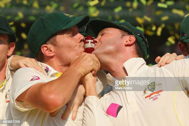 Peter Siddle and Michael Clarke of Australia kiss the urn celebrate victory in the test and the series during the presentation ceremony on day three...