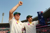 Peter Siddle and Mitchell Johnson of Australia celebrate winning the Ashes series 50 during day three of the Fifth Ashes Test match between Australia...