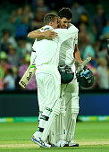 Peter Siddle and Mitchell Starc of Australia hug after winning the third test during day three of the Third Test match between Australia and New...