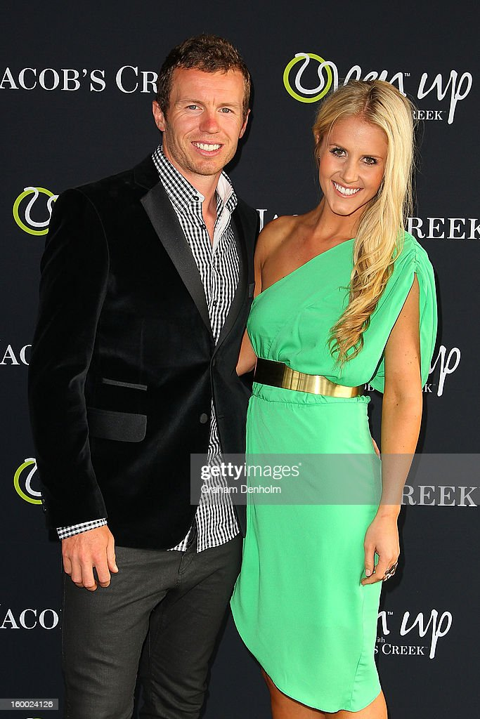 Peter Siddle (L) and partner Anna Weatherlake arrive at the screening of the Jacob's Creek Open Film Series 2 at Maia Docklands on January 25, 2013 in Melbourne, Australia.