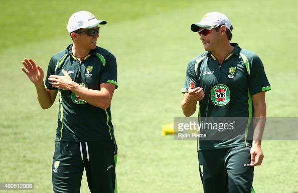Peter Siddle and Ryan Harris of Australia warm up during an Australian Nets Session at The Gabba on December 16 2014 in Brisbane Australia