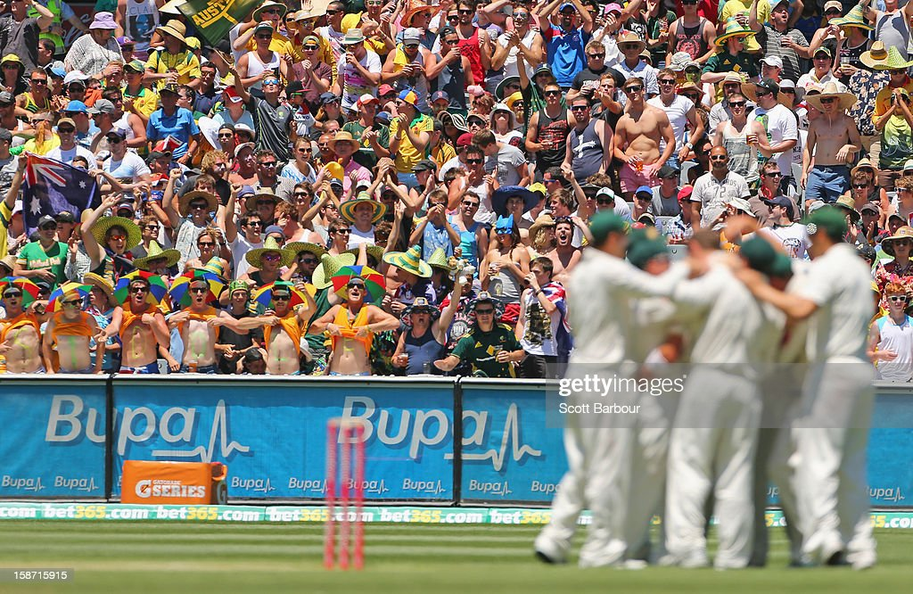 Peter Siddle fans show their support as Peter Siddle of Australia dismisses Angelo Mathews of Sri Lanka during day one of the Second Test match between Australia and Sri Lanka at Melbourne Cricket Ground on December 26, 2012 in Melbourne, Australia.