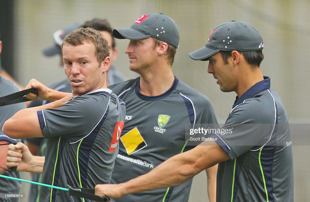 <a gi-track='captionPersonalityLinkClicked' href=/galleries/search?phrase=Peter+Siddle&family=editorial&specificpeople=2104718 ng-click='$event.stopPropagation()'>Peter Siddle</a>, Jackson Bird and Mitchell Johnson of Australia stretch an Australian training session at the Melbourne Cricket Ground on December 24, 2012 in Melbourne, Australia.